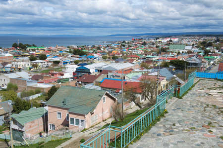 arenas: Punta Arenas, Chile - October 28, 2013 : Scenic view of Punta Arenas and Magellan strait in Punta Arenas, Chile. It is the southernmost city on the planet with population over 100 thousand located on continent.
