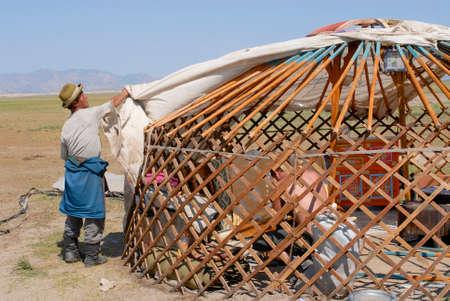 nomadic: Circa Harhorin, Mongolia, August 25, 2006 - Mongolian men assemble yurt (ger or nomadic tent) in steppe circa Harhorin, Mongolia.