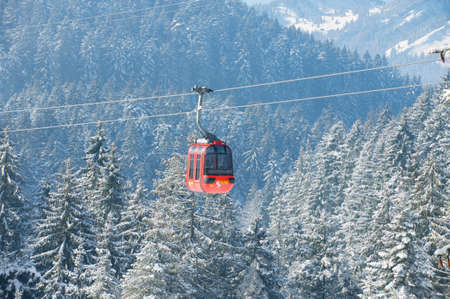 Circa Lucern, Switzerland - February 21, 2012 : Cable car gondola of the Pilatus cable car moves uphill to the Pilatus mountain viewpoint, circa Lucern, Switzerland.