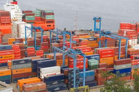 Valparaiso, Chile - October 18, 2013 : View to the cargo sea port of Valparaiso in Valparaiso, Chile. Valparaiso sea port is the busiest one in Chile.