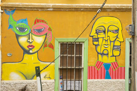 Valparaiso, Chile - October 19, 2013 : Colorful graffiti art presents at one of the exterior building walls in the historical city center in Valparaiso, Chile. Editorial
