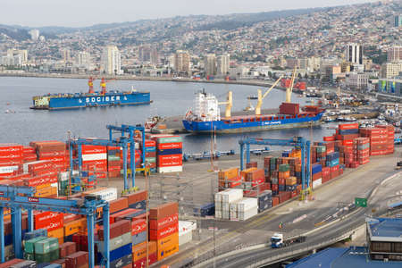 Valparaiso, Chile - October 18, 2013 : View to the cargo sea port and residential area of Valparaiso city in Valparaiso, Chile. Valparaiso sea port is the busiest one in Chile.