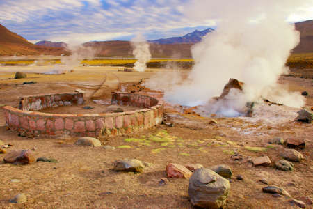 Beautiful El Tatio geysers at sunrise, Chile. Located at 4,320 meters above the sea level El Tatio geyser valley is one the highest elevated geyser field in the world