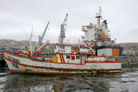 valparaiso: Valparaiso, Chile - October 19, 2013 : Fishing boat tied at the Valparaiso port in Valparaiso, Chile. Editorial
