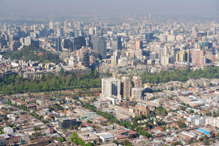 Aerial view of the Santiago city with the blue smog, filmed from the San Cristobal Hill, Santiago, Chile. photo