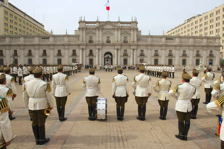 Santiago, Chile - October 18, 2013 : Military of the Carabineros band attend changing guard ceremony in front of the La Moneda presidential palace in Santiago, Chile.