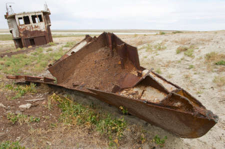 desertification: Rusted remains of fishing boat at the sea bed of the Aral sea, Aralsk, Kazakhstan. Evaporation of formerly one of four largest lakes in the world is considered one of the planet