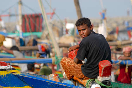 just arrived: Al Hudaydah, Yemen,  September 17, 2006 - Fisherman sits at the front side of the fishing boat just arrived to the port in Al Hudaydah, Yemen.