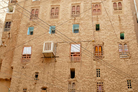 mud house: Exterior wall of the mud brick tower house in Shibam, Hadramaut valley, Yemen. UNESCO World Heritage site, often referred as \\\the oldest skyscraper city in the world\\\ or \\\the Manhattan of the desert\\\