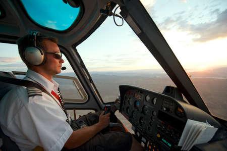 Circa Las Vegas, USA, July 27, 2010 - Man pilots helicopter to Grand Canyon at sunset circa Las Vegas, USA.