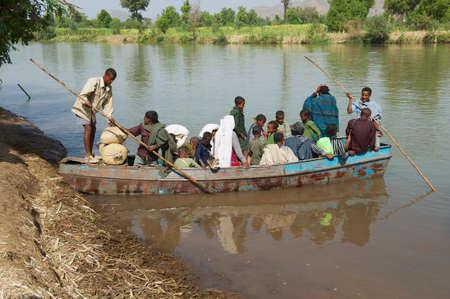 Bahir Dar, Ethiopia, January 21, 2010 - Passengers embark local ferry boat to cross the Blue Nile river in Bahir Dar, Ethiopia.