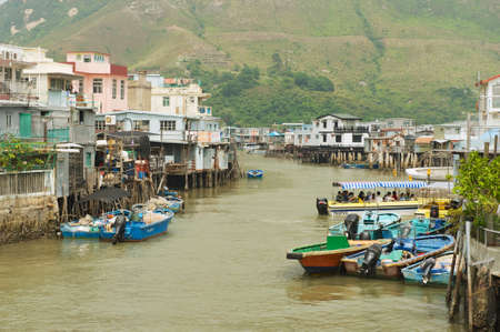 architecture alphabet: Hong Kong, China - September 15, 2012 : Exterior of the Tai O fishermen village with stilt houses and motorboats in Hong Kong, China. Tai O is a famous tourist destination in Hong Kong.