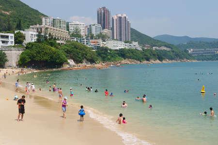 stanley: Hong Kong, China, September 16, 2012 - Tourists sunbathe at the Stanley town beach in Hong Kong, China. Stanley town is a tourist attraction in Hong Kong.