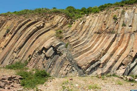 Bent hexagonal columns of volcanic origin at the Hong Kong Global Geopark in Hong Kong, China.