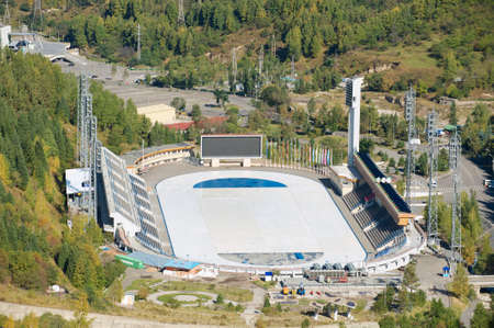 Almaty, Kazakhstan - September 17, 2011: Aerial view of the Medeo stadium in Almaty, Kazakhstan. Medeo stadium and skating rink is the highest located in the world - 1691 m. above sea level.