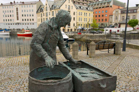 alesund: Alesund, Norway - June 03, 2010 : Exterior of the Herring woman sculpture in Alesund, Norway. Fishing (especially herring) industry historically was very important for Alesund.