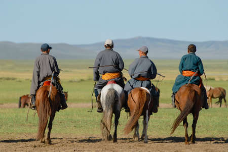 Circa Harhorin, Mongolia, August 19, 2006 - Men ride on horseback circa Harhorin, Mongolia.