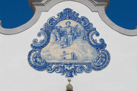 Exterior detail of the Saint Lawrence of Rome church in Almancil, Portugal. Church has one of the most beautiful in Portugal hand painted tiles (Azulejo) of the 18th century at the facade.