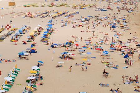 rocha: Portimao, Algarve, July 18, 2006 - People sunbathe at Praia da Rocha beach in Portimao, Portugal.