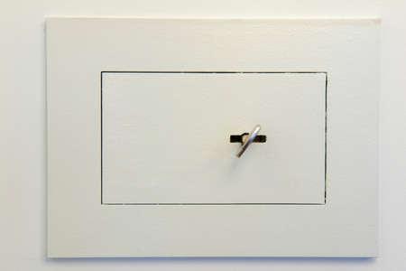 key box: Closed wall mounted safe box with a key. Stock Photo