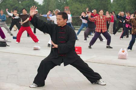chuan: Beijing, China, May 01, 2009 - People practice tai chi chuan gymnastics in Beijing, China.
