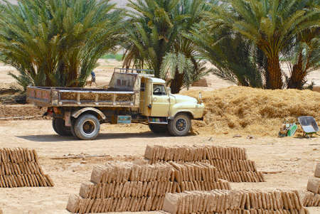 Shibam, Yemen - September 12, 2006 : Ready to load truck parked at the mud brick factory in Shibam, Yemen. Mud bricks is a traditional construction material in Hadramaut valley, Yemen.