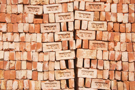 dhaka: Dhaka, Bangladesh - February 19, 2014 : Stack of bricks for sale in Dhaka, Bangladesh. Low quality brick is the only available construction material for people in Bangladesh.