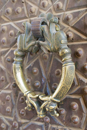 Vintage bronze door handle in Agha Bozorg mosque, Kashan, Iran. Stock Photo