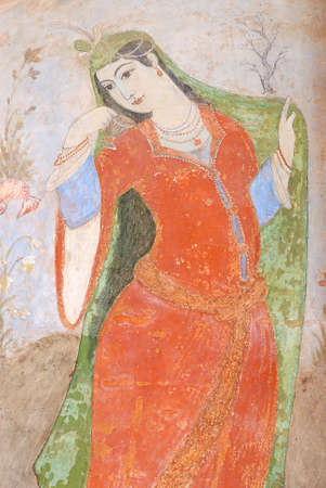Isfahan, Iran - June 25, 2007 : Interior of the Ali Qapu palace in Shiraz, Iran. Fresco depicts a wealthy Persian woman. Editorial