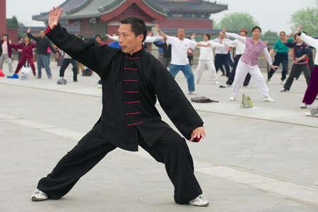 taichi: Beijing, China, May 01, 2009 - People practice tai chi chuan gymnastics in Beijing, China.
