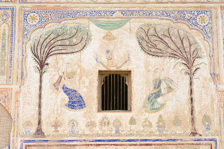 shekhawati: Mandawa, India - March 31, 2007 : Exterior wall paining detail of the haveli in Mandawa, India. Mandawa area has one of the largest concentration of frescos in the world.