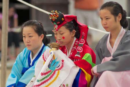 Yongin, Korea, September 02, 2008 - Women demonstrate traditional Korean wedding ceremony in Yongin, Korea.
