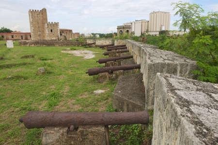 Old cannons at the fortress wall of Ozama Fortress in Santo Domingo, Dominican Republic. photo