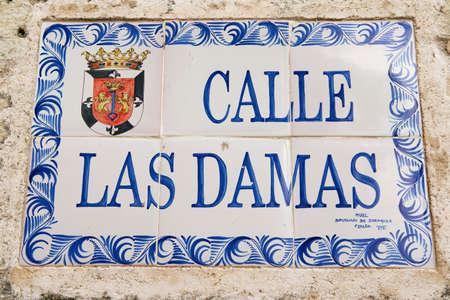 domingo: Santo Domingo, Dominican Republic - November 07, 2012 : Exterior of the vintage street name sign in Santo Domingo, Dominican Republic.