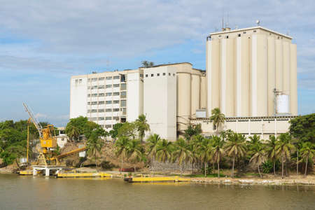 domingo: Santo Domingo, Dominican Republic - November 07, 2012 : View from the Ozama Fortress to the industrial building on the opposite side of the Ozama river in downtown Santo Domingo, Dominican Republic.