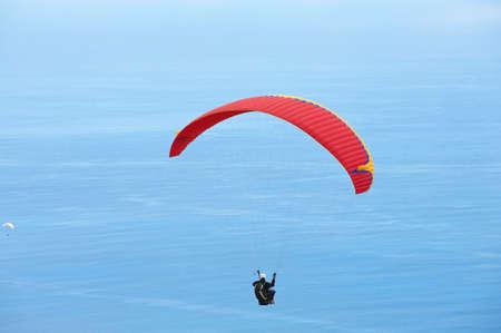 high flier: Les Colimatons Les Hauts De Reunion, France, December 04, 2010 - Paragliders fly over Indian ocean in Les Colimatons Les Hauts De Reunion, France.