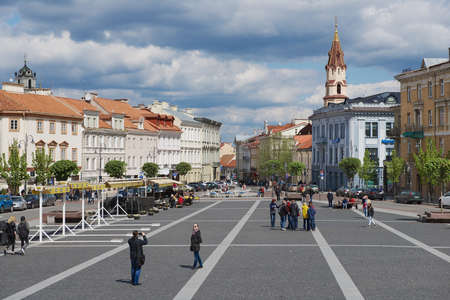 town hall square: Vilnius Lithuania May 02 2015  People walk by the Town Hall square in Vilnius Lithuania.