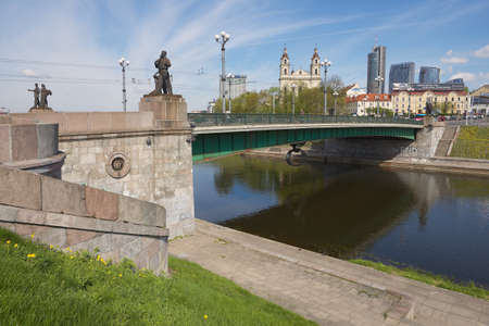 realism: Vilnius Lithuania  May 04 2015 : Exterior of the Green Bridge in Vilnius Lithuania. It is the oldest bridge in Vilnius decorated with Soviet realism sculptures.