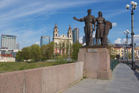 realism: Vilnius Lithuania  May 04 2015 : Exterior of the bronze sculpture of worker and farm woman in Soviet Realism style at the Green Bridge in Vilnius Lithuania. Editorial