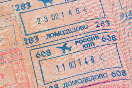 customs official: Passport page with the immigration control stamps of the Domodedovo airport in Moscow Russia.