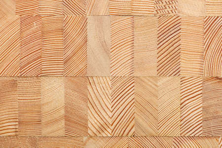 larch: Background with glued larch wooden blocks.