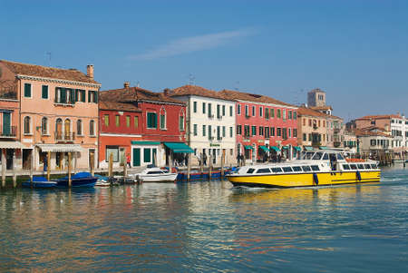Murano: Murano Italy February 27 2007: Public transportation boat passes by the Grand canal in Murano Italy.