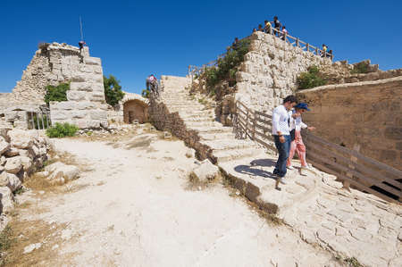 crusaders: Ajlun, Jordan, August 19, 2012 - Tourists visit Ajloun fortress in Ajloun, Jordan. This ayyubid castle was built in the 12th century, used by crusaders and arabs. Editorial