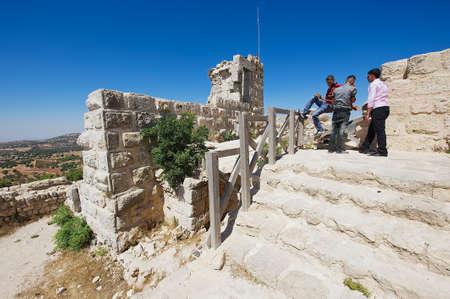 crusaders: Ajlun, Jordan, August 19, 2012 - People visit Ajloun fortress in Ajloun, Jordan. This ayyubid castle was built in the 12th century, used by crusaders and arabs.