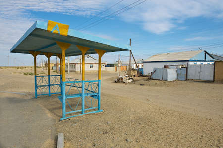depressive: Aralsk, Kazakhstan - September 22, 2011: Exterior of the bus stop in the town of Aralsk, Kazakhstan. After evaporation of the Aral sea formerly one of four largest lakes in the world, Aralsk became a depressive town. Aral evaporation is considered one of