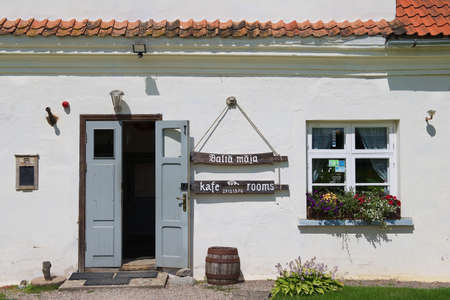 rundale: Pilsrundale, Latvia - July 27, 2015: Exterior of a cafe entrance in the traditional building in Pilsrundale, Latvia. Editorial