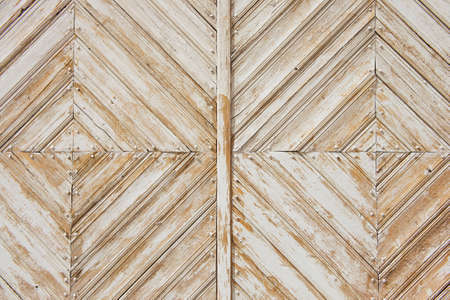 rhomb: Rhomb pattern of the old weathered white-painted wooden gate.