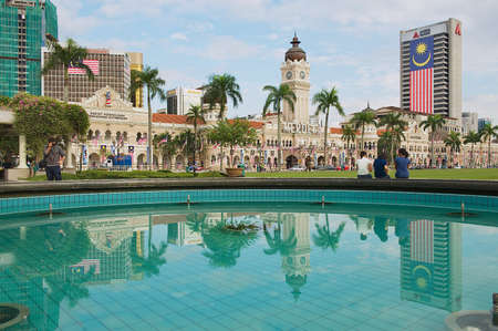 Kuala Lumpur, Malaysia - August 29, 2009: Exterior of the buildings at the Independence square reflected in the fountain in Kuala Lumpur, Malaysia. Editorial