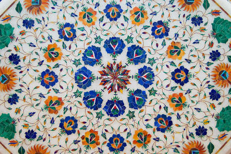 Agra, India - March 28, 2007: Exterior of the traditional colorful floral marble design produced by local muslim Bharai community in Agra, India.