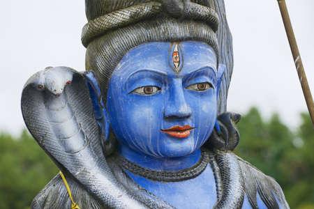 hindu god shiva: Exterior detail of the Shiva statue at Ganga Talao Grand Bassin Hindu temple, Mauritius. Its a copy of the Shiva statue of Sursagar Lake in Vadodara, Gujarat, India. Stock Photo